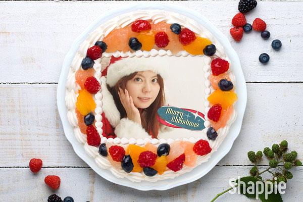 サンタコスチュームのクリスマス写真ケーキ